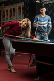Young Adults Playing Pool Royalty Free Stock Photography