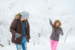 Young adults playing with snow Stock Images