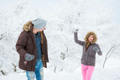 Young adults playing with snow Royalty Free Stock Photo