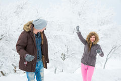Young adults playing with snow Royalty Free Stock Photos