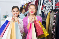 Young adults with purchases in shop Royalty Free Stock Photo