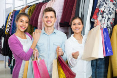 Young adults with purchases in shop Royalty Free Stock Photography