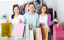 Young adults with purchases in shop Stock Photography