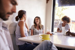 Young adults relaxing at a coffee shop, close up royalty free stock image