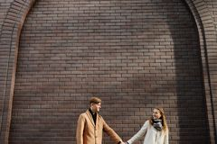Young adults romantic date happy together. Young adults in romantic relationship. Couple holding hands on a date. Happy together. Free space concept Royalty Free Stock Photos