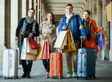Young adults in shopping tour. Happy young adults chasing streets in shopping tour outdoor Stock Image