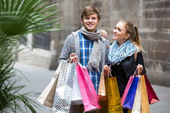 Young adults in shopping tour Royalty Free Stock Photo