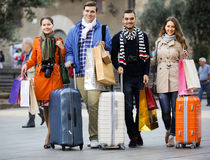 Young adults in shopping tour. Portrait of young adults chasing streets in shopping tour Stock Photography