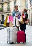 Young adults in shopping tour. Portrait of happy young adults chasing streets in shopping tour Stock Photography