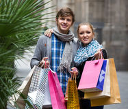 Young adults in shopping tour Stock Photos