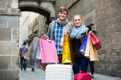 Young adults in shopping tour Royalty Free Stock Images