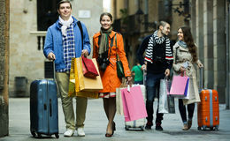 Young adults in shopping tour. Portrait of positive young adults chasing streets in shopping tour Stock Photography