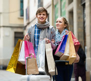 Young adults in shopping tour. Portrait of smiling young adults chasing streets in shopping tour Royalty Free Stock Photos