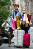 Young adults in shopping tour Stock Photo