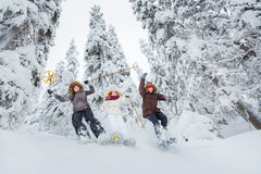 Young adults snowshoeing Royalty Free Stock Photography