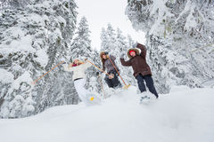 Young adults snowshoeing Royalty Free Stock Image