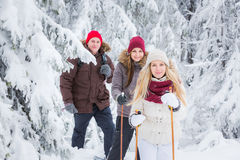 Young adults snowshoeing Stock Images