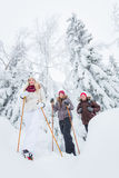 Young adults snowshoeing Stock Image