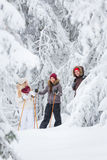 Young adults snowshoeing Royalty Free Stock Photos