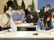 Young Adults studying. Large group of young adults studying in a classroom royalty free stock photos