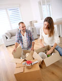 Young adults unpacking boxes Royalty Free Stock Photo