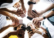 Young adults using smartphones in a circle social media and conn. Ection concept stock photo