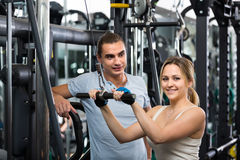 Young adults working out in fitness club Royalty Free Stock Photo