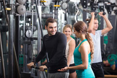 Young adults working out in fitness club Stock Photography