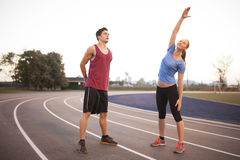 Young adults working out together Royalty Free Stock Image