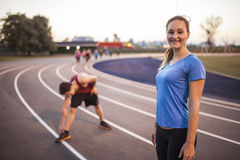 Young adults working out together Royalty Free Stock Photos