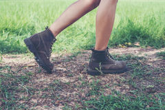 Young adventure woman feet walking on gravel in the forest. Royalty Free Stock Photo