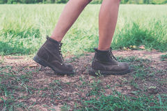 Young adventure woman feet walking on gravel in the park. Royalty Free Stock Photos