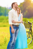 Young Affectionate Caucasian Couple Resting together in the Park Royalty Free Stock Photography