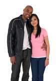 Young affectionate couple hugging. African American guy with Asian girlfriend Stock Images