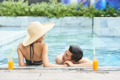 Couple relaxing at resort stock images