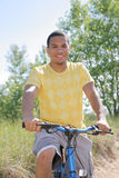 Young African American Biking Stock Photography