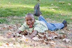 Young African American Boy Playing in the Park Stock Images