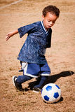 Young African American boy playing soccer Stock Photo