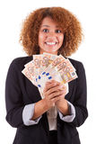 Young african american business woman holding euro bills - Afric Royalty Free Stock Images