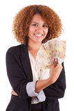 Young african american business woman holding euro bills - Afric Stock Images