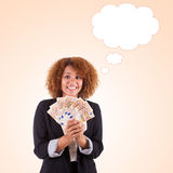Young african american business woman holding euro bills - Afric Stock Photography
