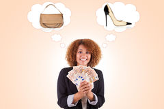 Young african american business woman holding euro bills - Afric Stock Image