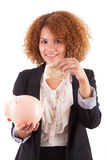 Young african american business woman holding a piggy bank - Afr. Young african american business woman holding a piggy bank, isolated on white background Stock Photos
