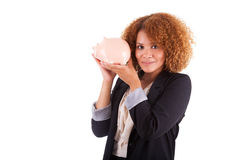 Young african american business woman holding a piggy bank - Afr Stock Image