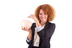 Young african american business woman holding a piggy bank - Afr Stock Photos