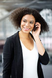 Young african american business woman talking on cellphone Royalty Free Stock Image