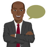 Young african american businessman with arms folded and speech bubble Stock Photo