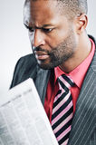 Young African American Businessman Being Sneaky On Laptop Royalty Free Stock Image