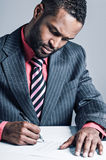 Young African American Businessman Being Sneaky On Laptop Stock Image