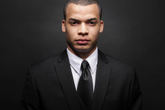 Young African-American businessman in black suit. Royalty Free Stock Photo